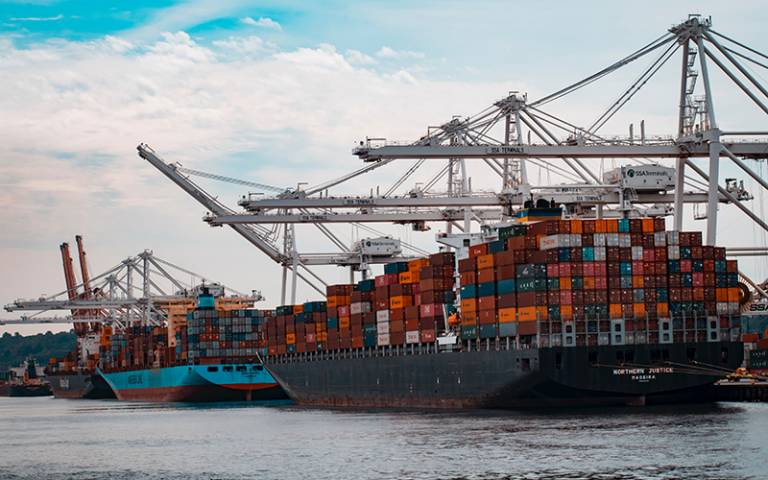 Photo shows freight shipping containers and cranes
