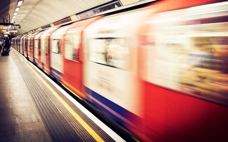 Train pulling in to London Underground station - Photo by Dan Roizer on Unsplash