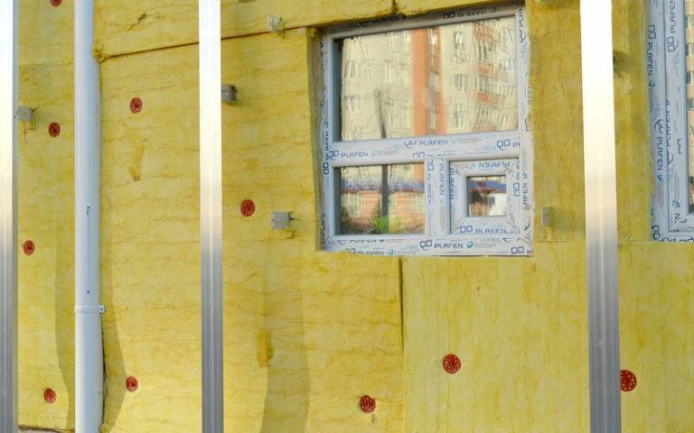 Insulation being installed on new housing