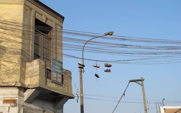 Photo shows power cables and a building in Lima, Peru