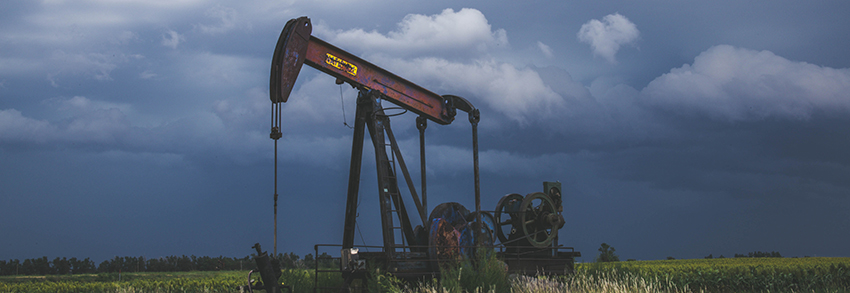 An oil pump in the middle of a field