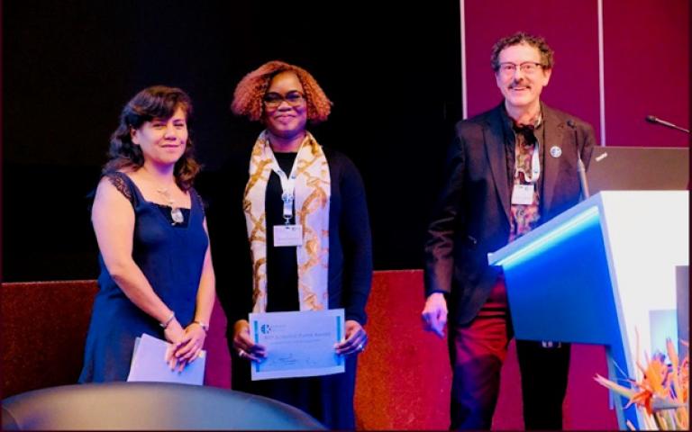 Dola Oluteye receding her award at the World Economic Forum Conference