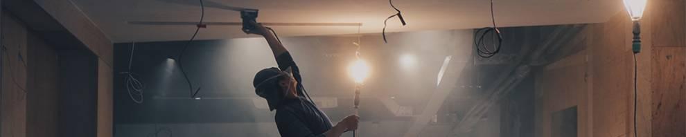Man plastering ceiling