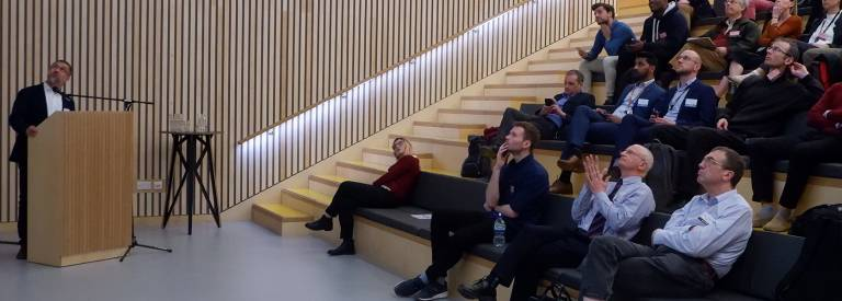 Academic and research staff watching a presentation at our Here East campus