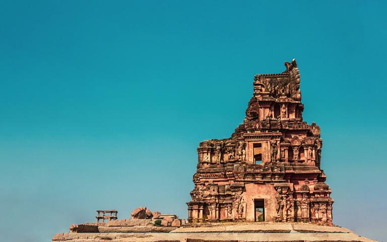 A broken spire of an ancient ruined temple in Hampi, Karnataka, India.
