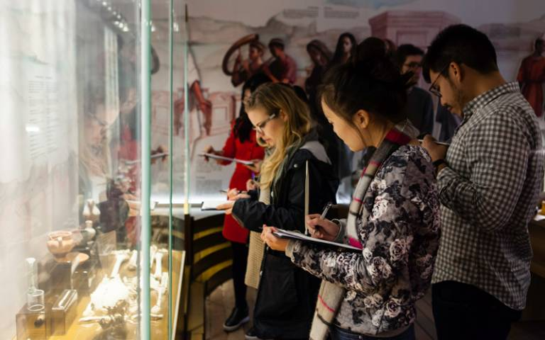 Students looking at museum exhibits in Malta