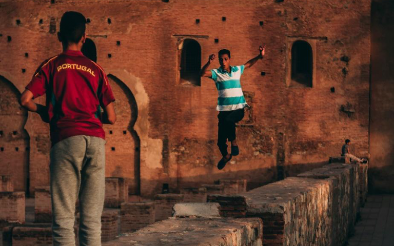 Photo shows teens playing around the walls of the Koutoubia Mosque in Marrakech.