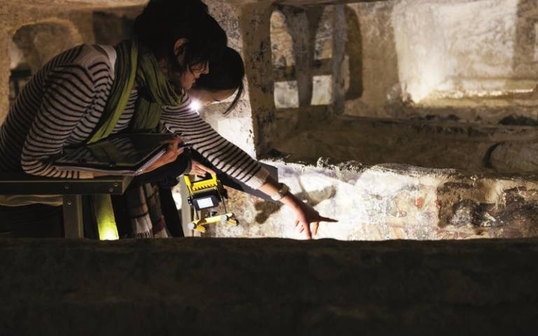 Students on a fieldtrip to Malta in the catacombs