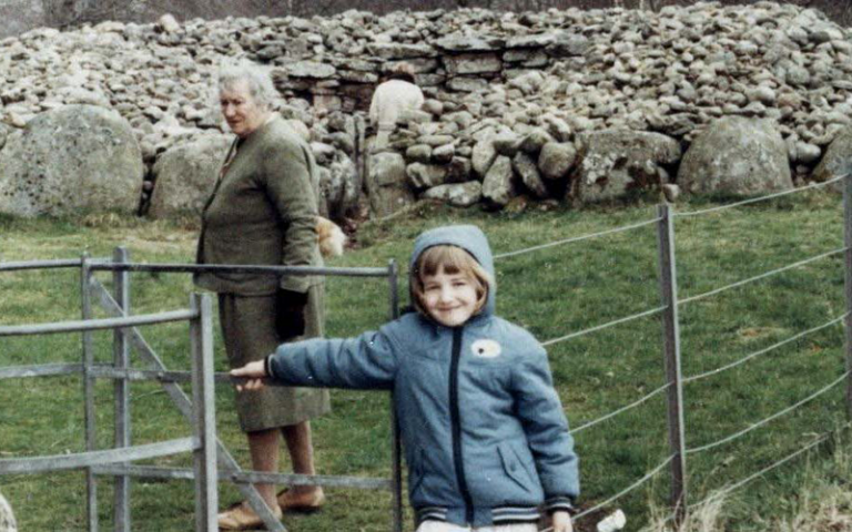 Holiday snap shows an adult and child at a stone heritage site in Scotland