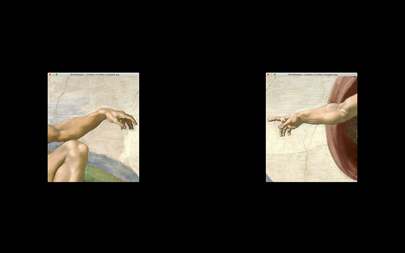 Photo shows the hands of God & Adam from Michelangelo's Creation of Adam separated on a computer screen.