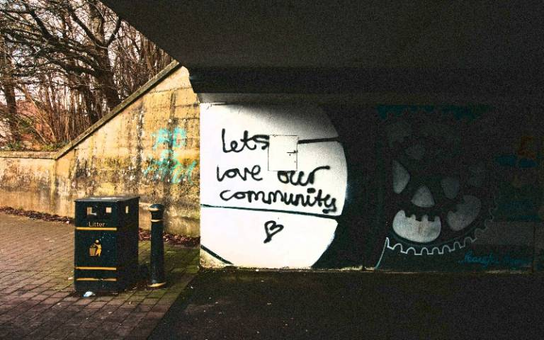 'Let's love our community' graffiti