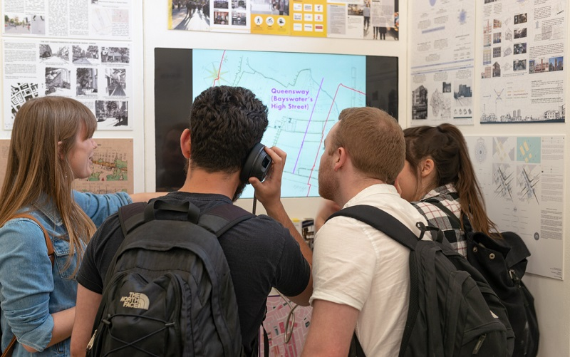 Four people viewing a screen