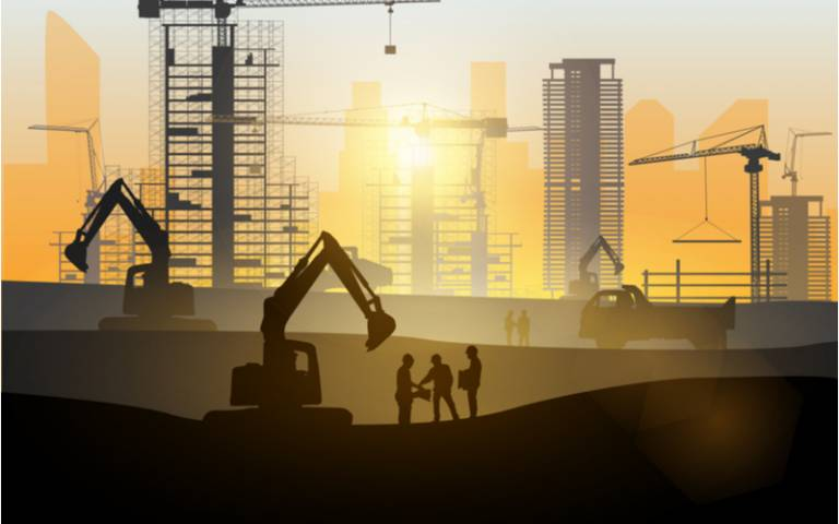Silhouette of engineer and construction team working at site over blurred background sunset pastel for industry background with Light fair
