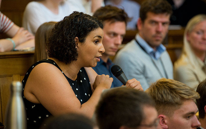 Woman asking a question at IIPP event