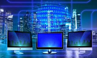 Computer screens, city, binary code