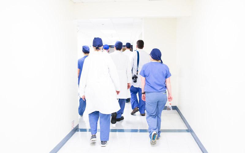 Doctors walking down a hospital corridor