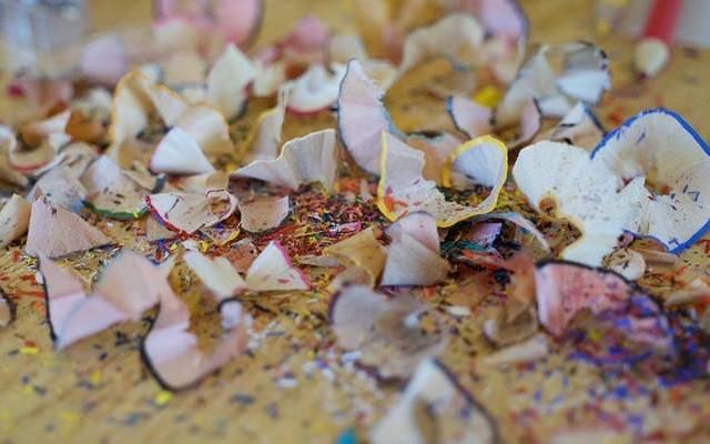 Pencil shavings in multicolours on a table top