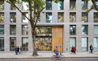 A bicycle rides past 22 Gordon Street, home of the Bartlett School of Architecture and Bartlett Faculty Office