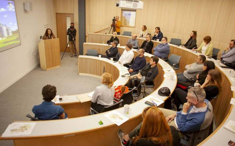 A group discussion takes place in a tiered small lecture theatre