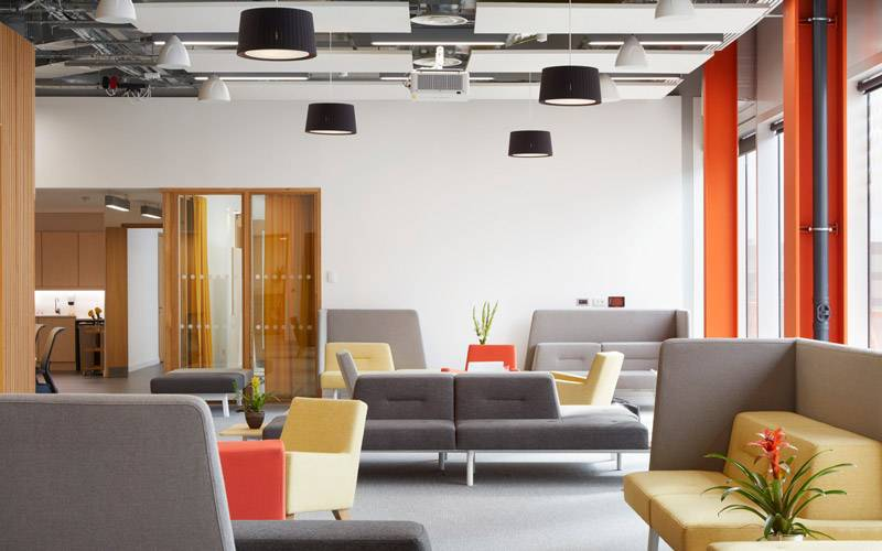 Open space with colourful sofas and tables in the Bartlett Real Estate Institute