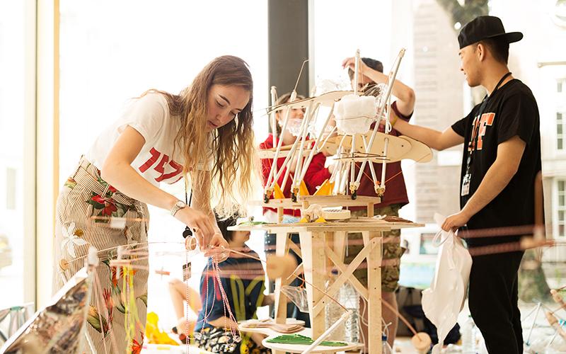 Students building wooden model