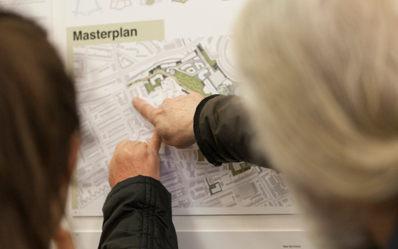 Two people looking at plan