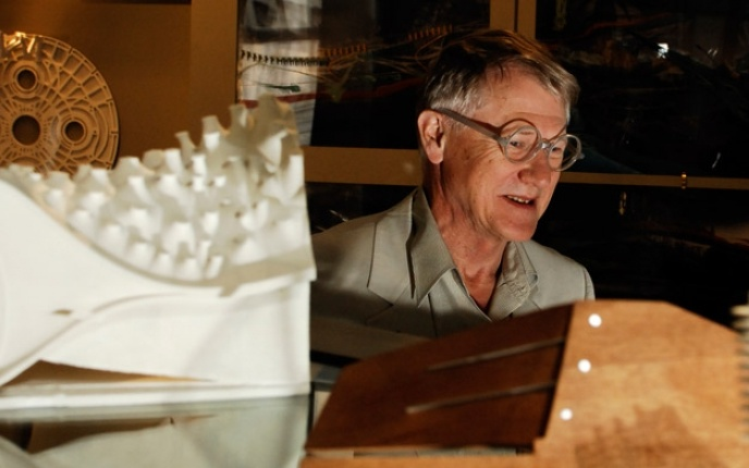 A visiting professor sitting as his desk