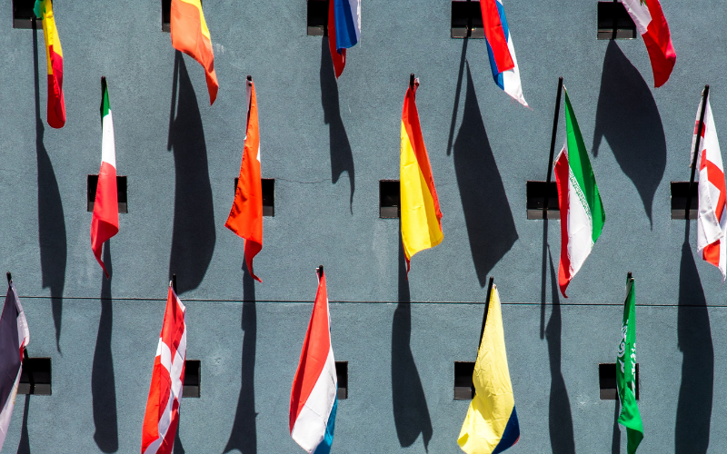 Flags against grey wall