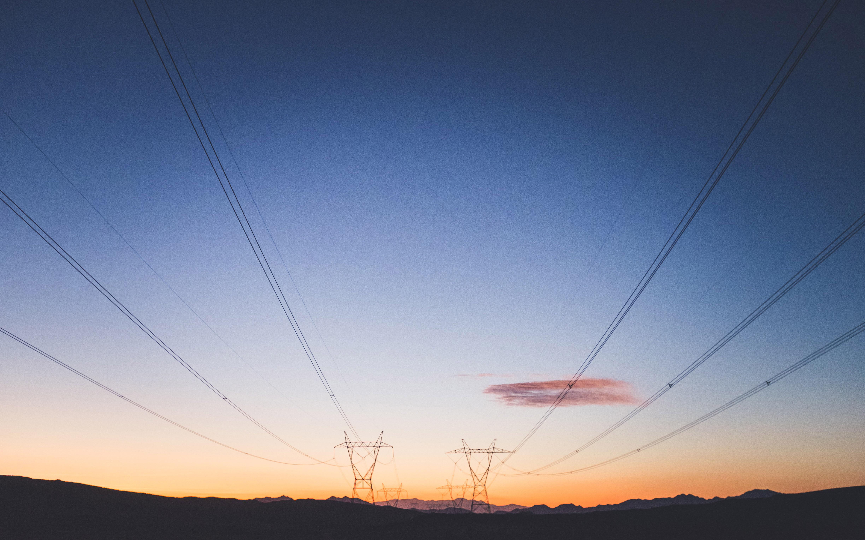 Pylons against dramatic sky