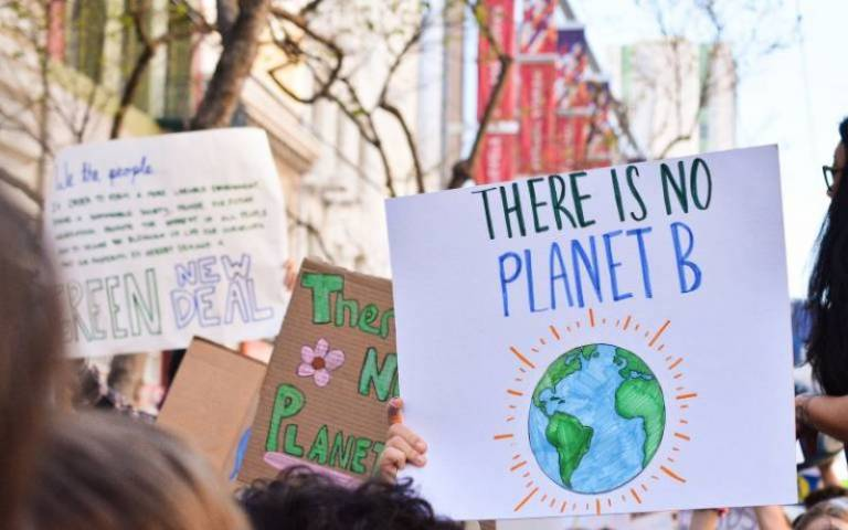 """Protester holding sign stating """"No Planet B"""""""
