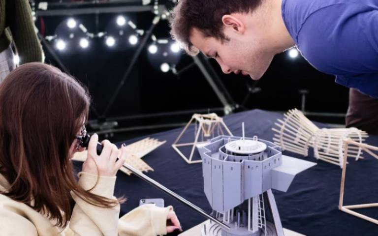 Students using artificial sky equipment