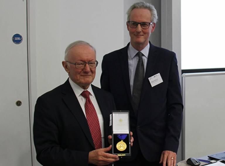 Professor Batty receiving medal