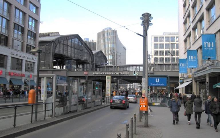 Berlin Transport Hub building with cars driving past the front