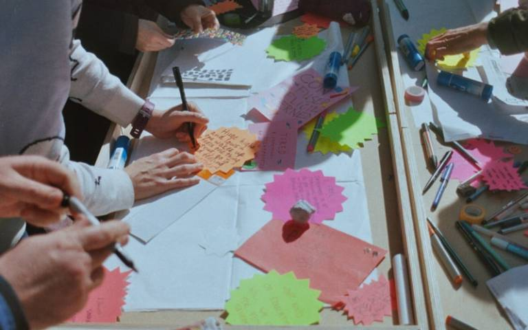 Participants during a creative workshop as part of the Research Interrupted project
