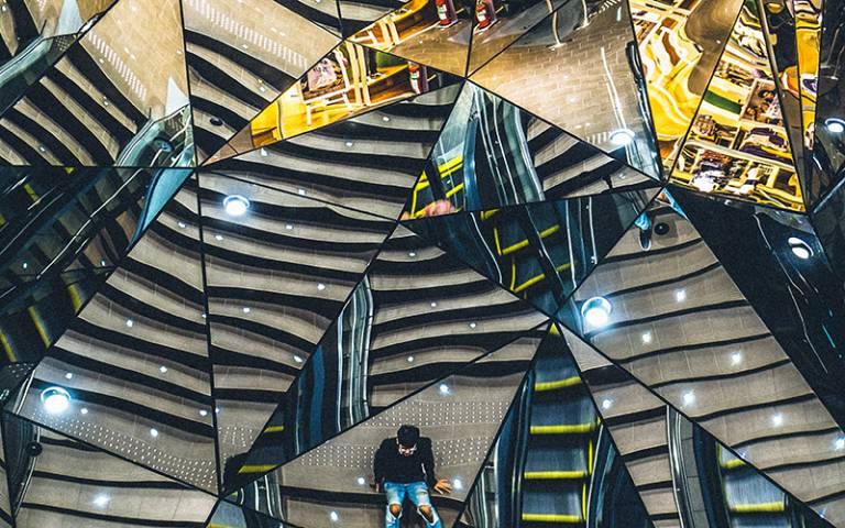 Mirrors reflecting stairs and escalators