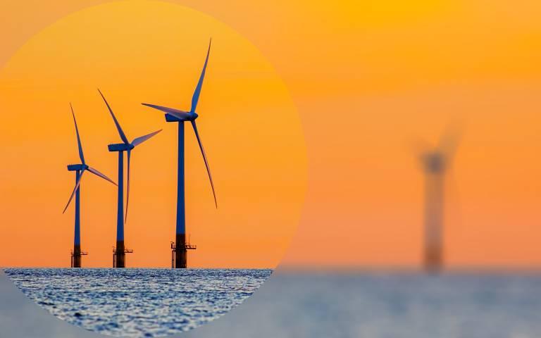 wind turbines with orange sky