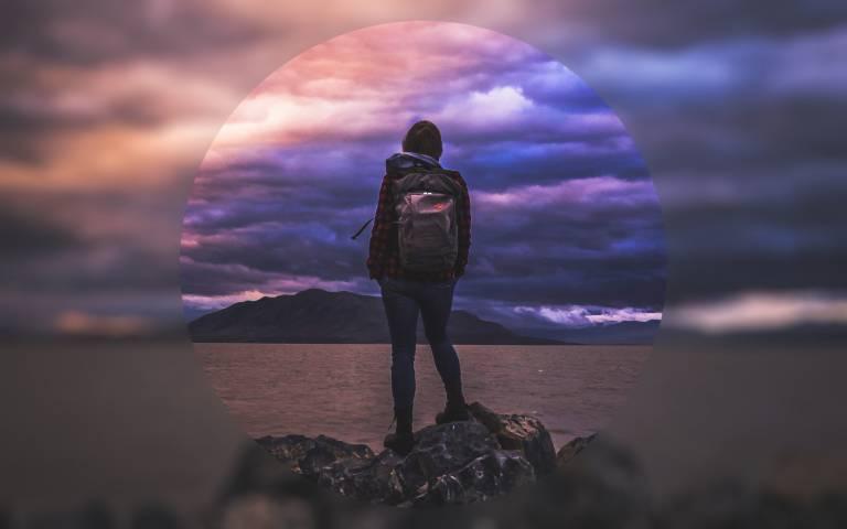 Girl looking at stormy horizon
