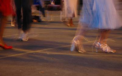 Feet of dancers in the street at night