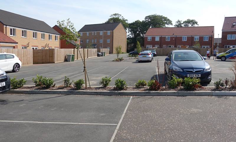 New build housing and parking spaces for vehicles