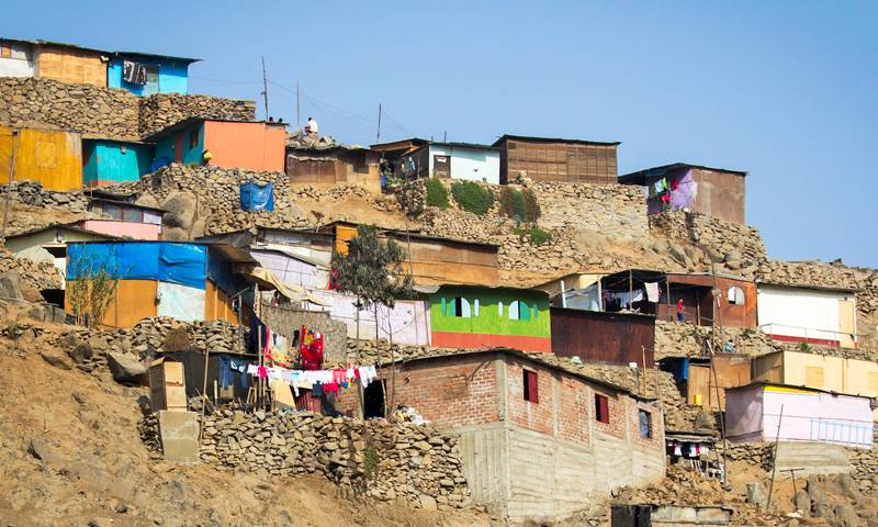 Brightly coloured buildings sit on a hillside