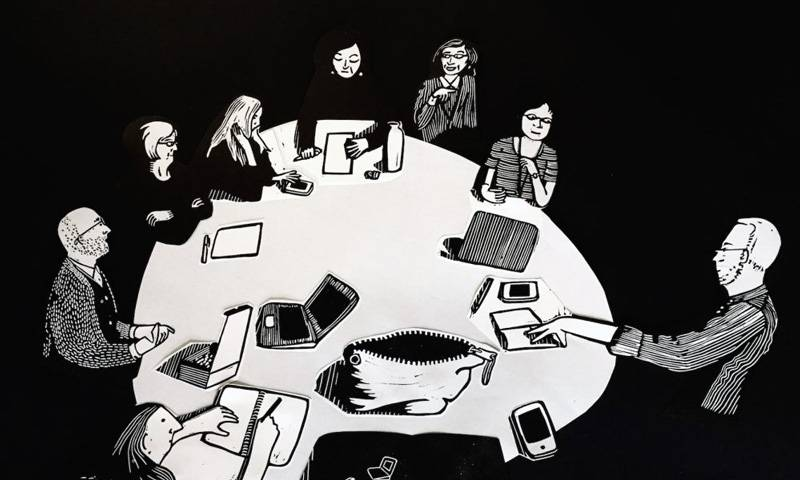 A black and white illustration of a group of people sitting around a large table having a discussion