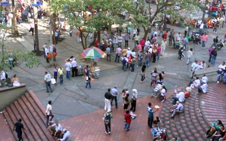 Medellin Transport Plaza is full of people relaxing and enjoying the sunshine