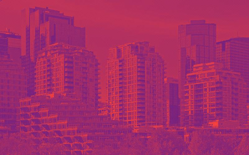 Landscape of three tall buildings in a city with a purple and red filter overtop