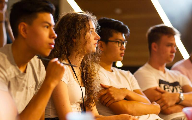 Four students concentrate in class