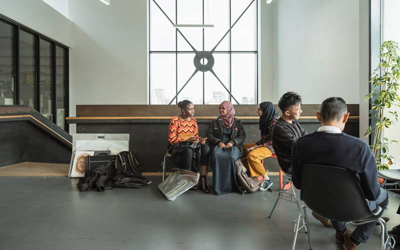 Students sitting in an open landing space at 22 Gordon Street London