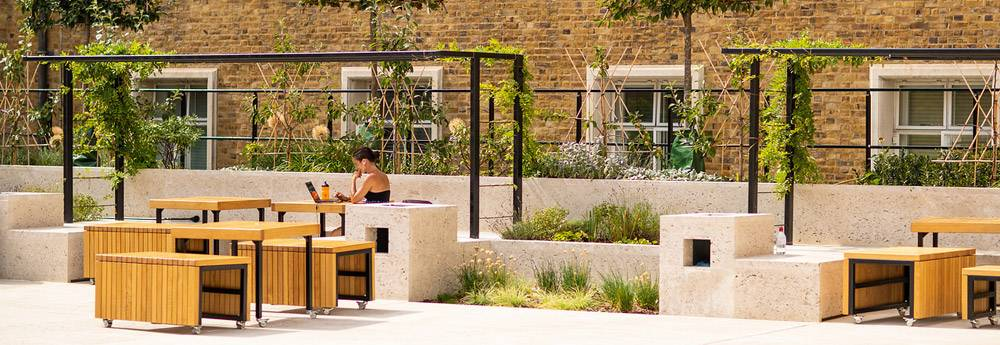 A student studies outside in Wilkins Terrace at UCLs Bloomsbury Campus