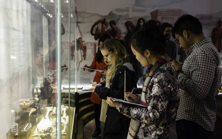 Students observing in a museum space