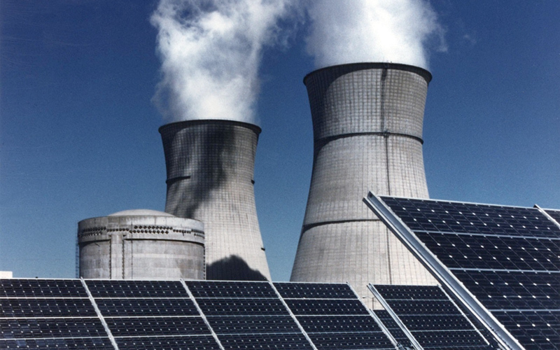 Cooling towers with solar panels in the foreground