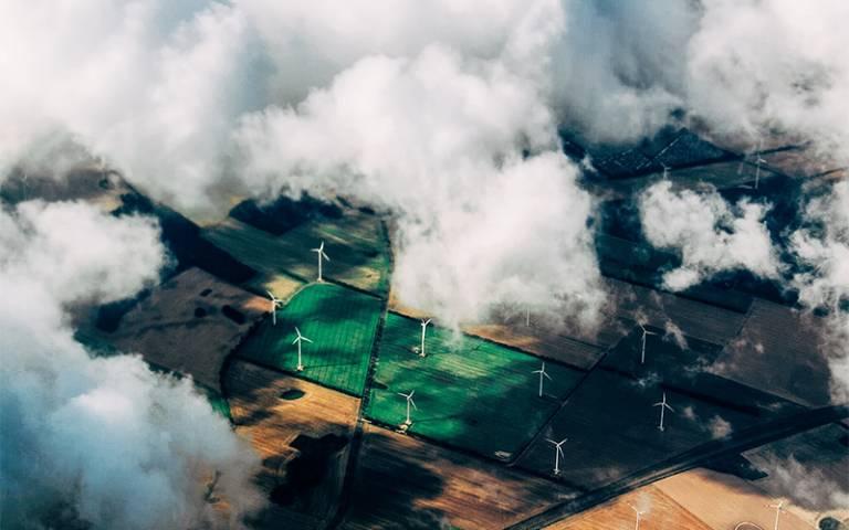 Wind turbines in field from bird's eye view