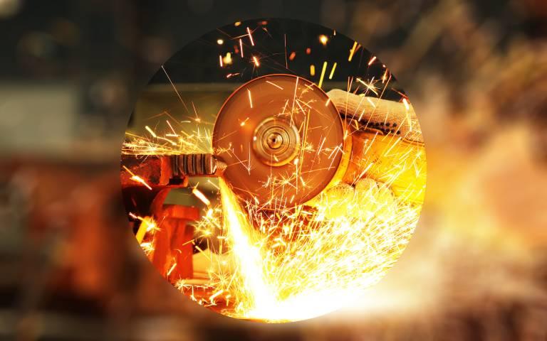 Worker cuts metal